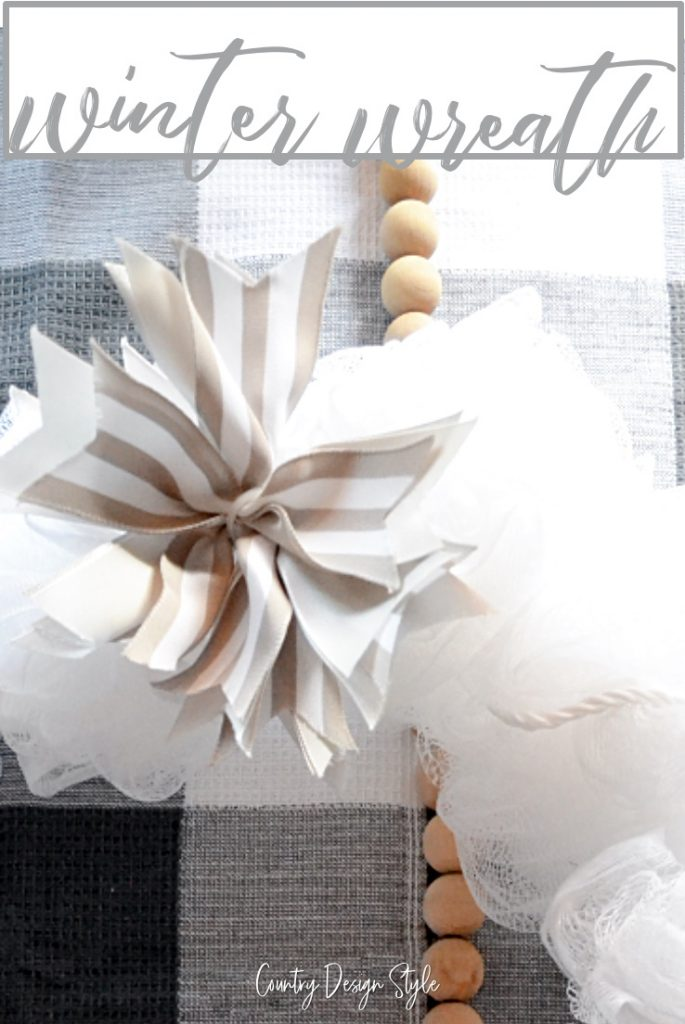 Close up of white wreath with bow