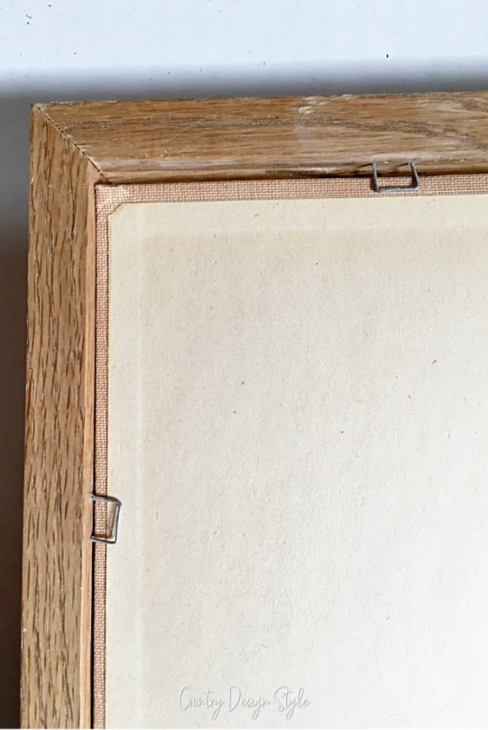 book held in place in frame