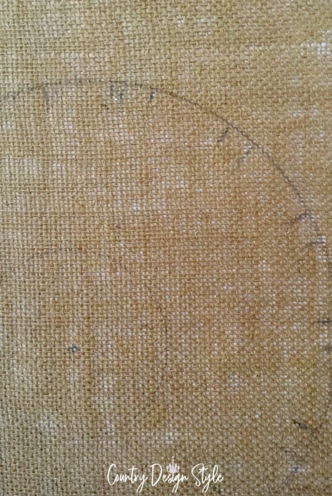 circle with tick marks on burlap