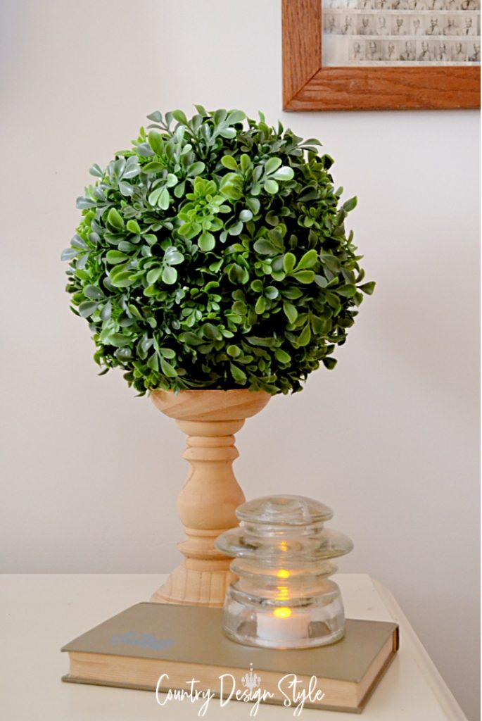 candleholder with round ball of faux greens on top