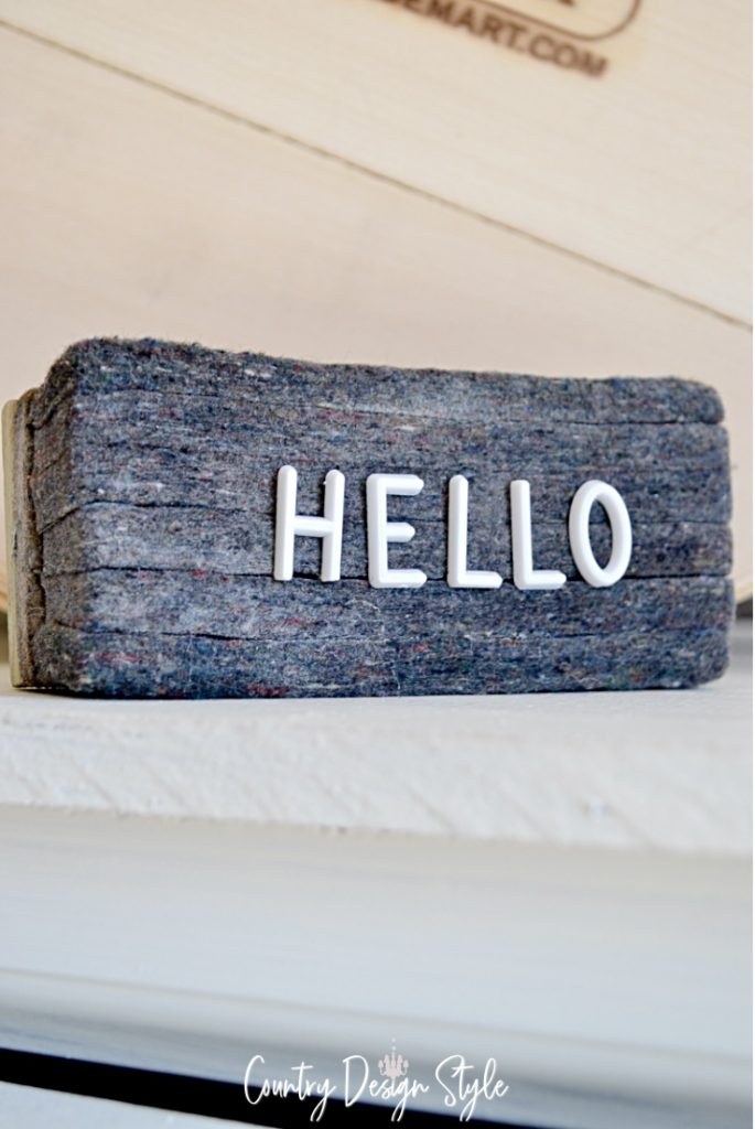Decor with eraser and letterboard letters in the word hello