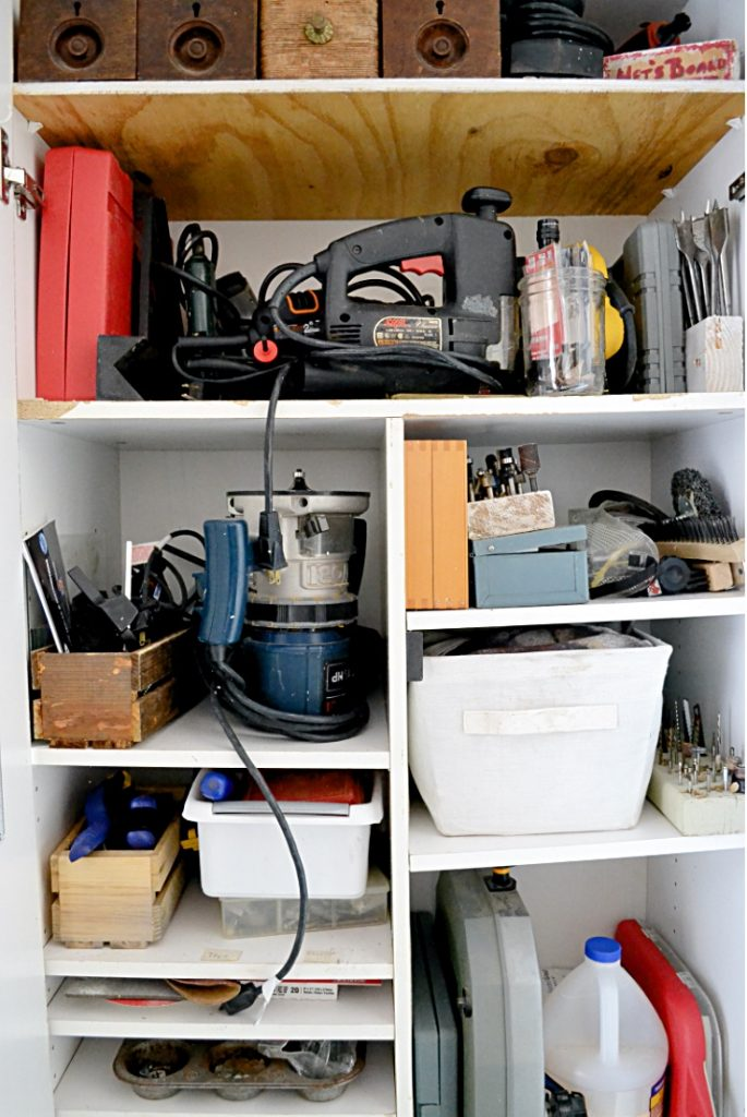 Tools in cabinet in she shed interiors for woodworking