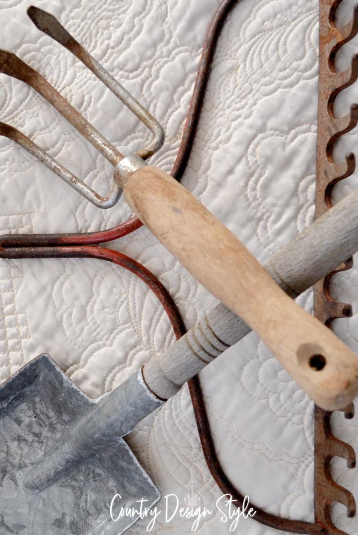 pile of vintage garden tools