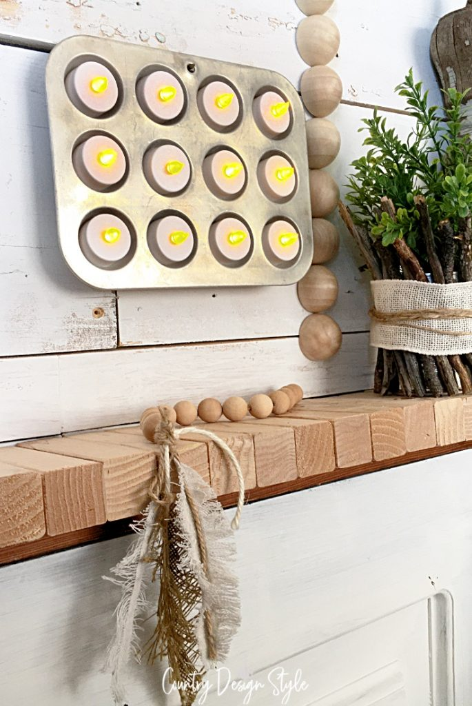 tin hanging on wall with candles