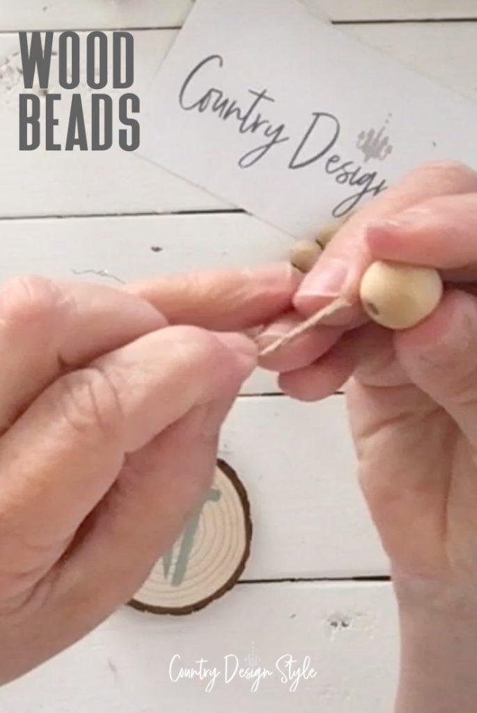 adding twine to wood beads