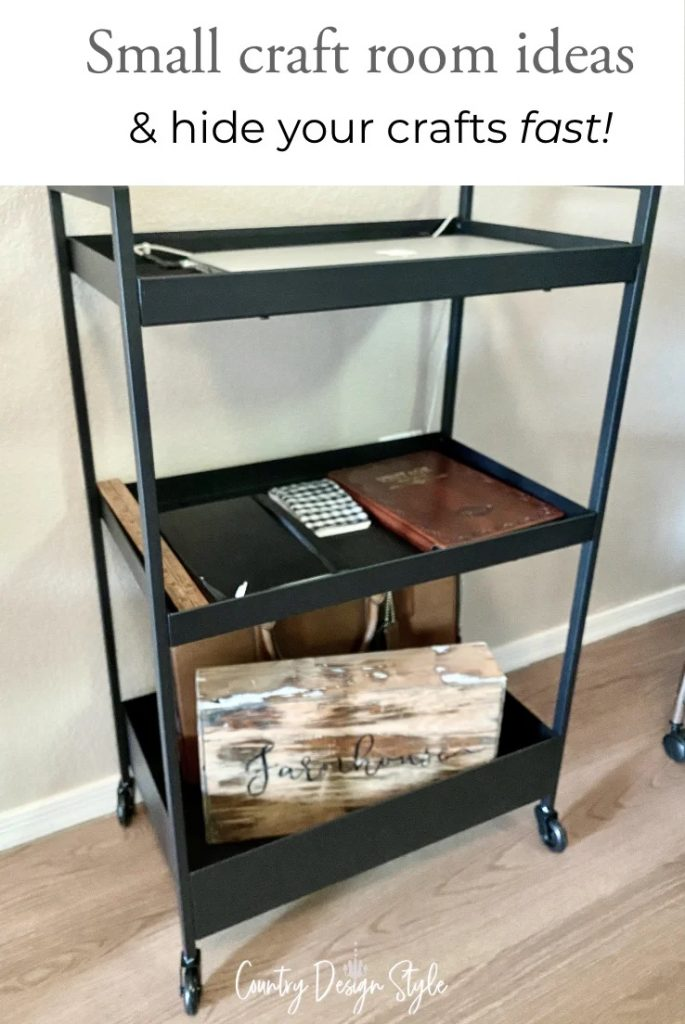 Black cart with laptop, tablet, phone and office supplies